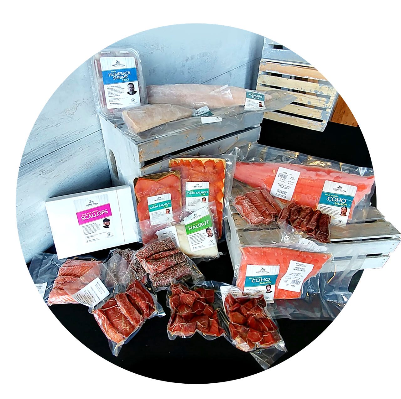 Example of a $300 share: a box of scallops, several packs of smoked and candied salmon, a pack of shrimp, several fillets of both salmon and white fish.